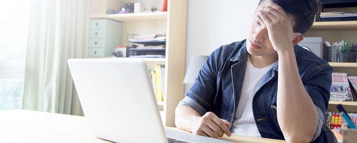 man looking at computer trying to financially recovering from covid19