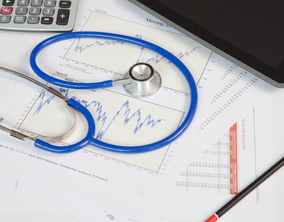 financial check up - stethoscope with documents