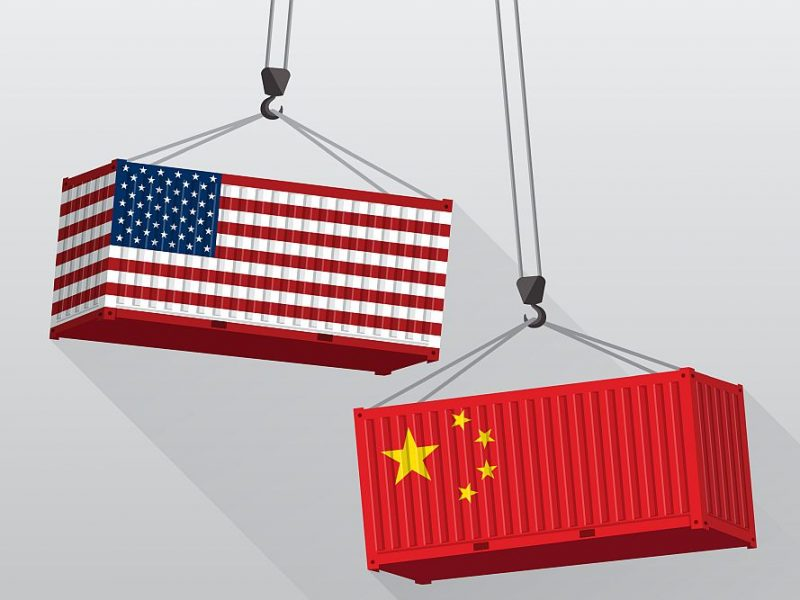 Geopolitamerical flag and chinese flag representing Geopolitical Risks for the Economy