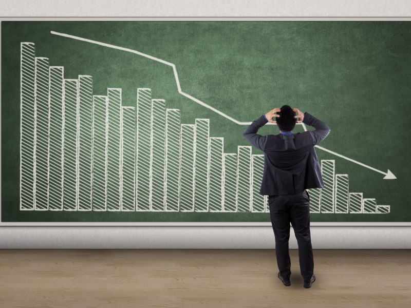 Prepare Your Finances For a Recession - man standing in front of black board